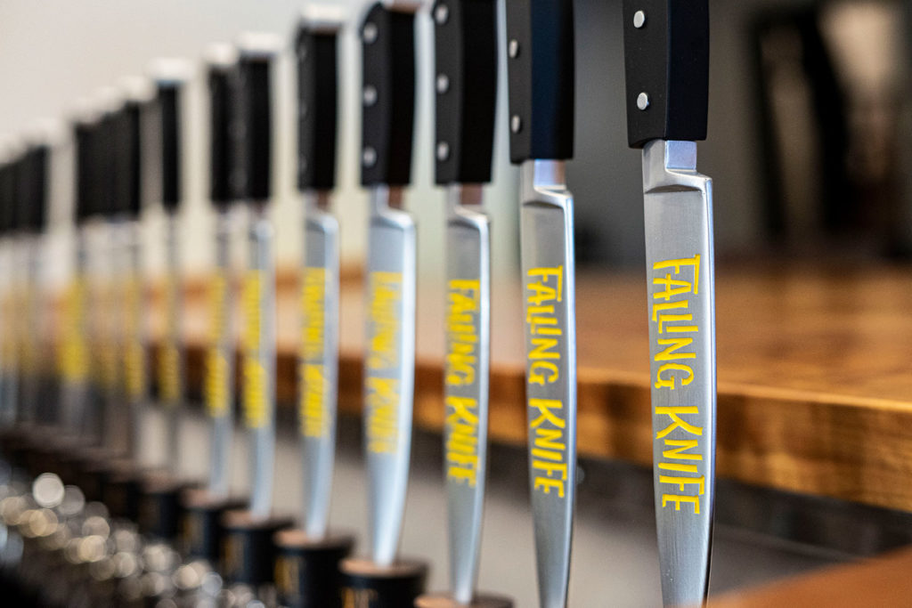 Falling Knife Brewing Co. tap handles closeup