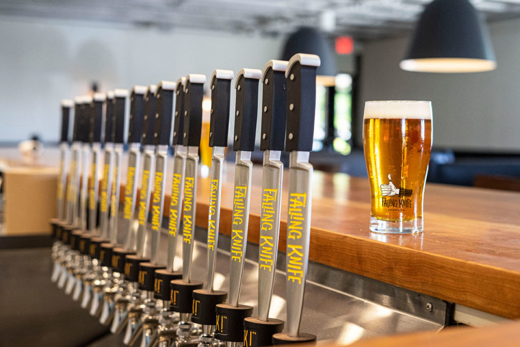 Falling Knife Brewing Co. tap handles and pint of beer